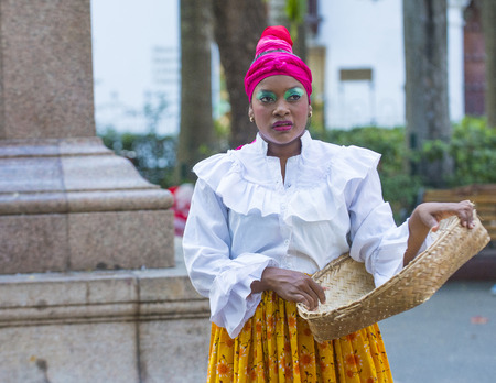 spanish ethnicity: CARTAGENA , COLOMBIA - FEB 04 : Street performer in Cartagena Colombia on February 04 2016. The historic port city Cartagena is UNESCO World Heritage Site since 1984.