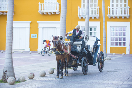 horse drawn: CARTAGENA , COLOMBIA - FEB 04 :  A Horse drawn carriage in Cartagena Colombia on Februery 04 2016. The historic port city Cartagena is UNESCO World Heritage Site since 1984.