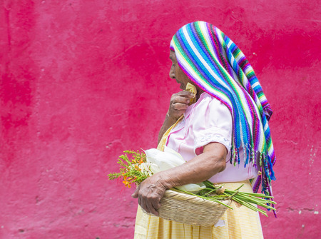 cristian: PANCHIMALCO , EL SALVADOR - MAY 08 : Portrait of an old Salvadoran woman during the Flower & Palm Festival in Panchimalco, El Salvador on May 08 2016 Editorial