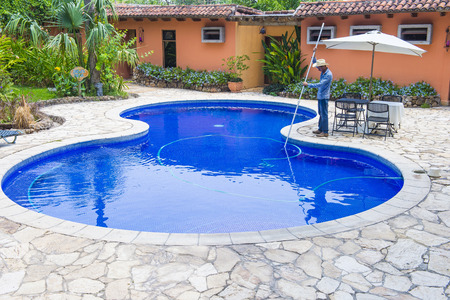 spaniards: SUCHITOTO , EL SALVADOR - MAY 07 : A swimming pool in Suchitoto El Salvador on May 07 2016. the colonial town of Suchitoto built by the Spaniards in the 18th century Editorial