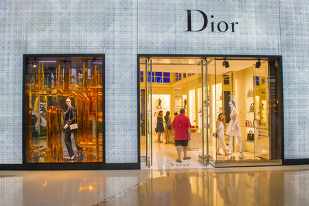 the existing: LAS VEGAS - MAY 21 : Exterior of a Dior store in Las Vegas strip on May 21 , 2016.  Dior is famous French luxury brand existing since 1946. Editorial