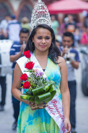 PANCHIMALCO , EL SALVADOR - MAY 08 : Salvadoran girl during the procession of the Flower & Palm Festival in Panchimalco, El Salvador on May 08 2016
