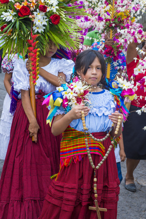 PANCHIMALCO , EL SALVADOR - MAY 08 : Salvadorian people participate in the procession of the Flower & Palm Festival in Panchimalco, El Salvador on May 08 2016 Editorial