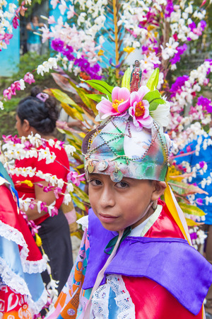 PANCHIMALCO , EL SALVADOR - MAY 08 : Salvadoran boy participate in the procession of the Flower & Palm Festival in Panchimalco, El Salvador on May 08 2016 Editorial