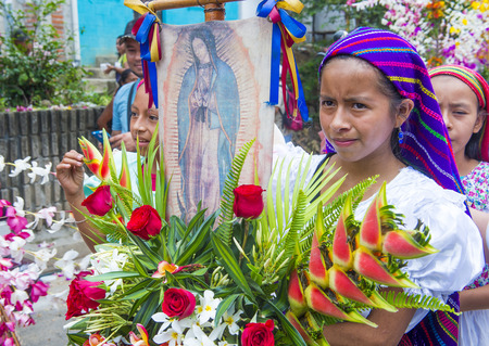 PANCHIMALCO , EL SALVADOR - MAY 08 : Salvadorian girls participate in the procession of the Flower & Palm Festival in Panchimalco, El Salvador on May 08 2016 Editorial