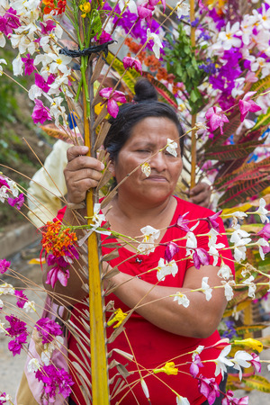 PANCHIMALCO , EL SALVADOR - MAY 08 : Salvadoran woman participate in the procession of the Flower & Palm Festival in Panchimalco, El Salvador on May 08 2016