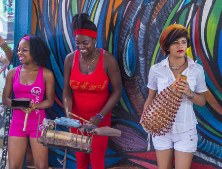 originated: HAVANA, CUBA - JULY 18 : Rumba musicians in Havana Cuba on July 18 2016. Rumba is a secular genre of Cuban music involving dance, percussion, and song. It originated in the northern regions of Cuba