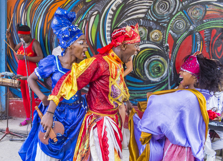 originated: HAVANA, CUBA - JULY 18 : Rumba dancers in Havana Cuba on July 18 2016. Rumba is a secular genre of Cuban music involving dance, percussion, and song. It originated in the northern regions of Cuba Editorial