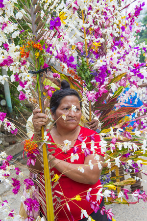 cristian: PANCHIMALCO , EL SALVADOR - MAY 08 : Salvadoran woman participate in the procession of the Flower & Palm Festival in Panchimalco, El Salvador on May 08 2016