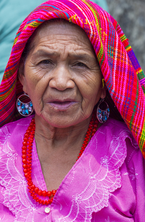PANCHIMALCO , EL SALVADOR - MAY 08 : Portrait of an old Salvadoran woman during the Flower & Palm Festival in Panchimalco, El Salvador on May 08 2016 Editorial