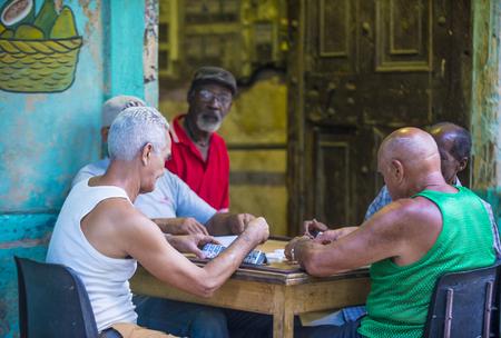ethnics: HAVANA, CUBA - JULY 18 : Unidentified men play dominos on the street on July 18 2016 in Havana , Cuba. Domino is one of the most popular games in Cuba Editorial