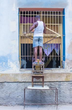 adobe wall: HAVANA, CUBA - JULY 18 : A portrait of a Cuban man in old Havana street on July 18 2016. The historic center of Havana is UNESCO World Heritage Site since 1982.