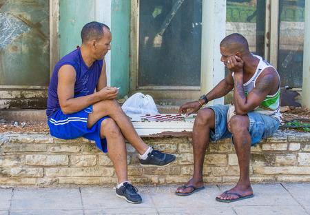 ethnics: HAVANA, CUBA - JULY 18 : Unidentified men play Checkers on the street on July 18 2016 in Havana , Cuba. Checkers is one of the most popular games in Cuba