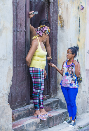 adobe wall: HAVANA, CUBA - JULY 18 : Cuban people stand in old Havana street on July 18 2016. The historic center of Havana is UNESCO World Heritage Site since 1982. Editorial