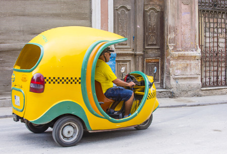 auto rickshaw: HAVANA, CUBA - JULY 18 : A Cocotaxi in old Havana street on July 18 2016. Cocotaxi is an auto rickshaw type taxi vehicle a cheap way to go from one point to the other in Havana.