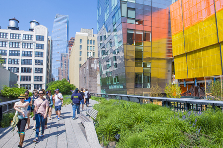 manhattans: NEW YORK CITY - MAY 28 : The High Line Park in NYC on May 28, 2016. The High Line is a public park built on an historic freight rail line elevated above the streets on Manhattans West Side. Editorial