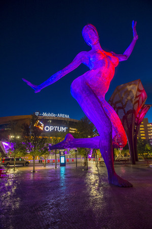 strip dance: LAS VEGAS - JUNE 14 : The T-Mobile arena and the Bliss Dance sculpture in Las Vegas on June 14 2016.  The arena is located west of the Las Vegas Strip and has 20,000 seat capacity