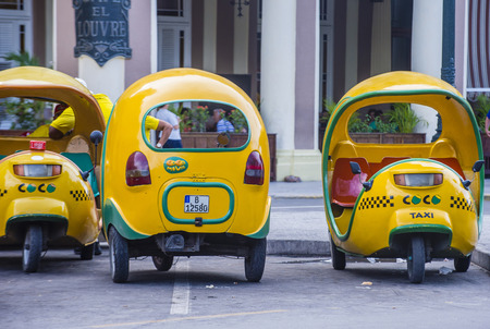 auto rickshaw: HAVANA, CUBA - JULY 18 : A Cocotaxis in old Havana street on July 18 2016. Cocotaxi is an auto rickshaw type taxi vehicle a cheap way to go from one point to the other in Havana.