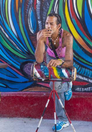 rumba: HAVANA, CUBA - JULY 18 : Cuban Rumba drummer in Havana  Cuba on July 18 2016. Rumba is a secular genre of Cuban music involving dance, percussion, and song. It originated in the northern regions of Cuba