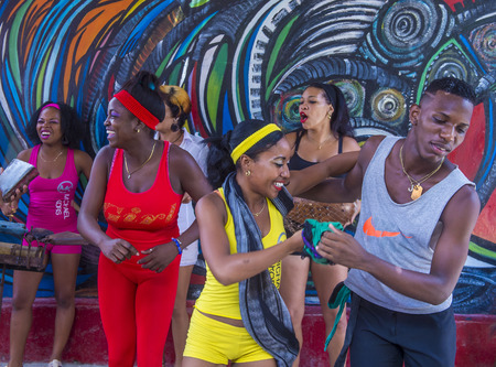 genre: HAVANA, CUBA - JULY 18 : Rumba dancers in Havana Cuba on July 18 2016. Rumba is a secular genre of Cuban music involving dance, percussion, and song. It originated in the northern regions of Cuba Editorial