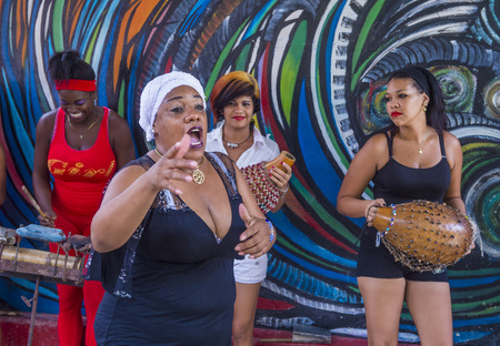 involving: HAVANA, CUBA - JULY 18 : Rumba musicians in Havana Cuba on July 18 2016. Rumba is a secular genre of Cuban music involving dance, percussion, and song. It originated in the northern regions of Cuba