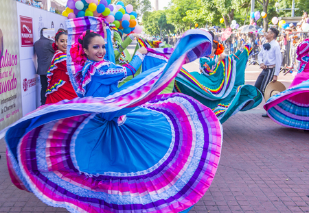 GUADALAJARA , MEXICO - AUG 28 : Participants in a parde during the 23rd International Mariachi & Charros festival in Guadalajara Mexico on August 28 , 2016.