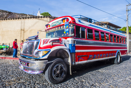 ANTIGUA, GUATEMALA - JULY 31: A typical Guatemalan Chicken Bus in Antigua, Guatemala on July 31, 2015. Chicken Bus Its a name for colorful, modified and decorated bus in various Latin American countries Editorial