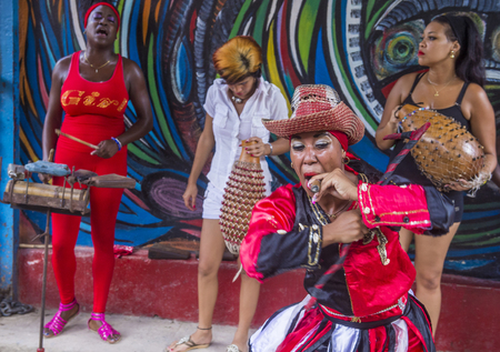 involving: HAVANA, CUBA - JULY 18 : Rumba dancers in Havana Cuba on July 18 2016. Rumba is a secular genre of Cuban music involving dance, percussion, and song. It originated in the northern regions of Cuba Editorial