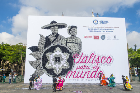 show folk: GUADALAJARA , MEXICO - AUG 26 :  Mosaic made with Mexican traditional hats in Guadalajara, Mexico, on August 26, 2016. Its Guinness record for the worlds largest mosaic made with hats