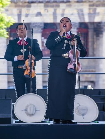 GUADALAJARA , MEXICO - AUG 28 : Mariachis perform on stage at the 23rd International Mariachi & Charros festival in Guadalajara Mexico on August 28 , 2016.
