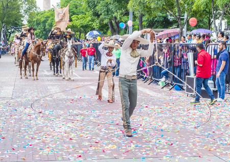 traje mexicano: GUADALAJARA , MEXICO - AUG 28 : Participants in a parde during the 23rd International Mariachi & Charros festival in Guadalajara Mexico on August 28 , 2016.