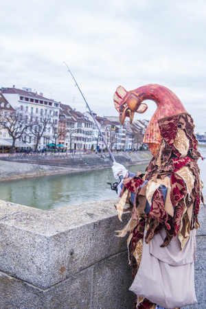 BASEL , SWITZERLAND - MARCH 08 : Participant in the Basel Carnival in Basel , Switzerland on March 08 2017. The Basel carnival has been listed as one of the top local festivities in Europe Editorial