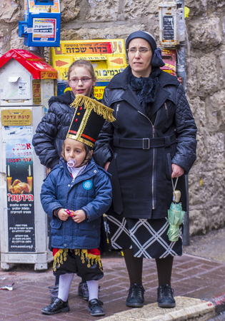 hasidic: JERUSALEM - MARCH 13 : Ultra Orthodox family during Purim in Mea Shearim Jerusalem on March 13 2017 , Purim is a Jewish holiday celebrates the salvation of the jews from genocide in ancient Persia