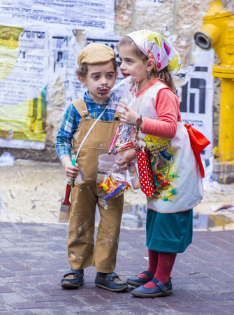 hasidic: JERUSALEM - MARCH 13 : Ultra Orthodox children during Purim in Mea Shearim Jerusalem on March 13 2017 , Purim is a Jewish holiday celebrates the salvation of the jews from genocide in ancient Persia