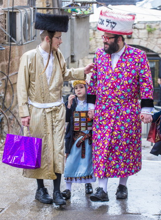 shearim: JERUSALEM - MARCH 13 : Ultra Orthodox men during Purim in Mea Shearim Jerusalem on March 13 2017 , Purim is a Jewish holiday celebrates the salvation of the jews from genocide in ancient Persia