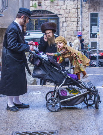 shearim: JERUSALEM - MARCH 13 : Ultra Orthodox family during Purim in Mea Shearim Jerusalem on March 13 2017 , Purim is a Jewish holiday celebrates the salvation of the jews from genocide in ancient Persia