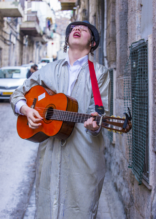 shearim: JERUSALEM - MARCH 13 : Ultra Orthodox boy during Purim in Mea Shearim Jerusalem on March 13 2017 , Purim is a Jewish holiday celebrates the salvation of the jews from genocide in ancient Persia Editorial