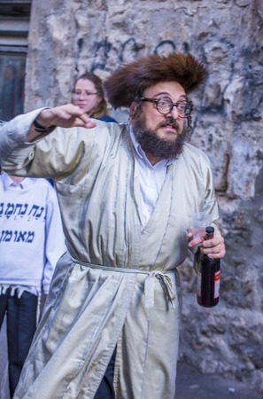 hasidic: JERUSALEM - MARCH 13 : Ultra Orthodox drunk man during Purim in Mea Shearim Jerusalem on March 13 2017 , Purim is a Jewish holiday celebrates the salvation of the jews from genocide in ancient Persia