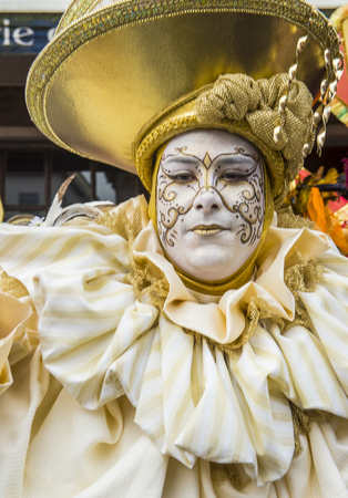 26: BINCHE , BELGIUM - FEB 26 : Participant in the Binche Carnival in Binche, Belgium on February 26 2017. The Binche carnival is included in a list of intangible heritage by UNESCO.