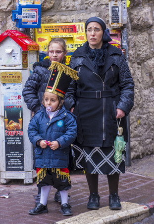 mea: JERUSALEM - MARCH 13 : Ultra Orthodox family during Purim in Mea Shearim Jerusalem on March 13 2017 , Purim is a Jewish holiday celebrates the salvation of the jews from genocide in ancient Persia