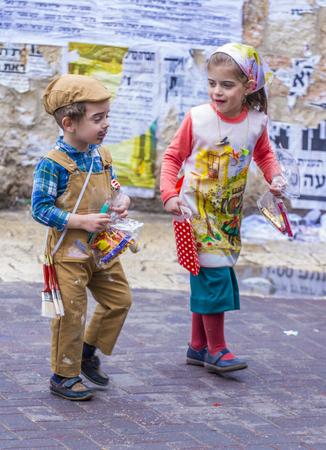 jewish: JERUSALEM - MARCH 13 : Ultra Orthodox children during Purim in Mea Shearim Jerusalem on March 13 2017 , Purim is a Jewish holiday celebrates the salvation of the jews from genocide in ancient Persia