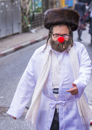 shearim: JERUSALEM - MARCH 13 : Ultra Orthodox man during Purim in Mea Shearim Jerusalem on March 13 2017 , Purim is a Jewish holiday celebrates the salvation of the jews from genocide in ancient Persia