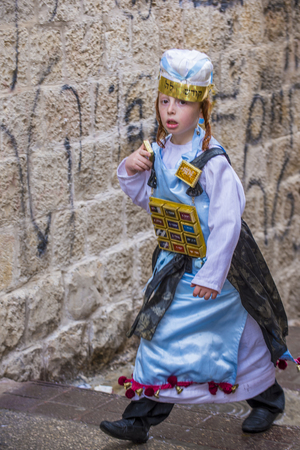 JERUSALEM - MARCH 13 : Ultra Orthodox child during Purim in Mea Shearim Jerusalem on March 13 2017 , Purim is a Jewish holiday celebrates the salvation of the jews from genocide in ancient Persia Editorial