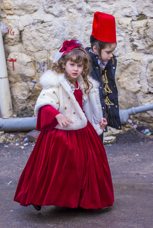shearim: JERUSALEM - MARCH 13 : Ultra Orthodox children during Purim in Mea Shearim Jerusalem on March 13 2017 , Purim is a Jewish holiday celebrates the salvation of the jews from genocide in ancient Persia