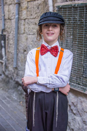 jewish: JERUSALEM - MARCH 13 : Ultra Orthodox child during Purim in Mea Shearim Jerusalem on March 13 2017 , Purim is a Jewish holiday celebrates the salvation of the jews from genocide in ancient Persia Editorial