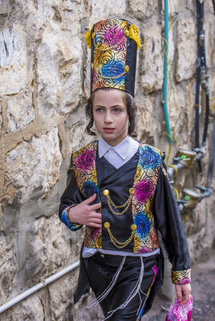 shearim: JERUSALEM - MARCH 13 : Ultra Orthodox child during Purim in Mea Shearim Jerusalem on March 13 2017 , Purim is a Jewish holiday celebrates the salvation of the jews from genocide in ancient Persia Editorial