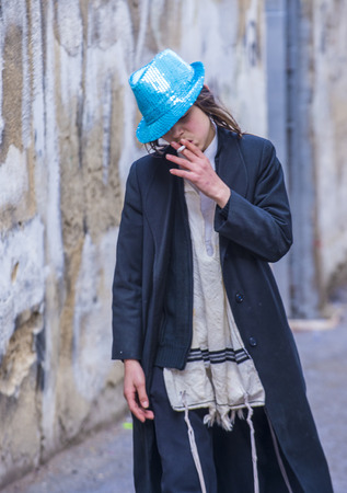 shearim: JERUSALEM - MARCH 13 : Ultra Orthodox drunk boys during Purim in Mea Shearim Jerusalem on March 13 2017 , Purim is a Jewish holiday celebrates the salvation of the jews from genocide in ancient Persia Editorial
