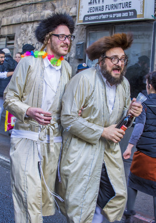 shearim: JERUSALEM - MARCH 13 : Ultra Orthodox drunk man during Purim in Mea Shearim Jerusalem on March 13 2017 , Purim is a Jewish holiday celebrates the salvation of the jews from genocide in ancient Persia