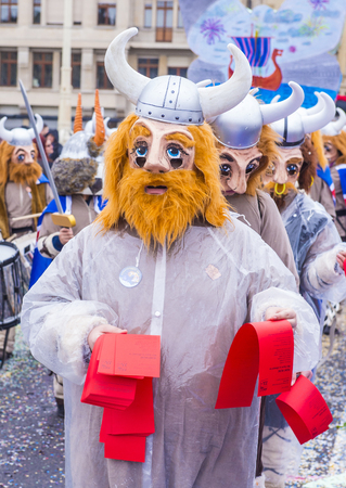 BASEL , SWITZERLAND - MARCH 08 : Participants in the Basel Carnival in Basel , Switzerland on March 08 2017. The Basel carnival has been listed as one of the top local festivities in Europe