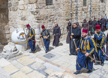 JERUSALEM - APRIL 13 : A procession of monks during Easter in the church of the holy sepulcher in Jerusalem Israel on April 13 2017 Editorial